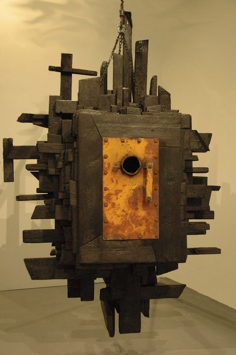 "Pictured here is a sculpture by Michael Enn Sirvet called the ""Dream Machine"".  Like most of his art works the sculpture was created around a found object in this case a door or hatch that he had found in an old Baltimore factory.  Initially he had intended to make a beautiful piece but during the process it turned out to be coming from a very dark place.  A place where the horrors that are the result of the battle between nature and modernity have an overwhelming quality.  This unique creative process of finding an object then creating a sculpture around that object strongly reflects the idea behind most postmodern thought."