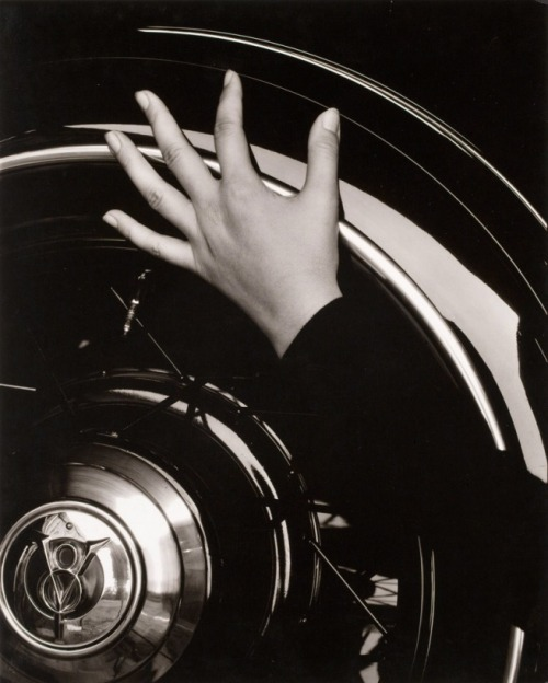 silfarione:  Georgia O'Keefe hand on back tire of Ford V8 by Alfred Steiglitz. 1933
