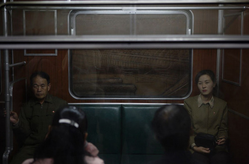 mpdrolet: Passengers riding in silence on a commuter train in the North Korean capital Pyongyang, 2010 Christopher Morris