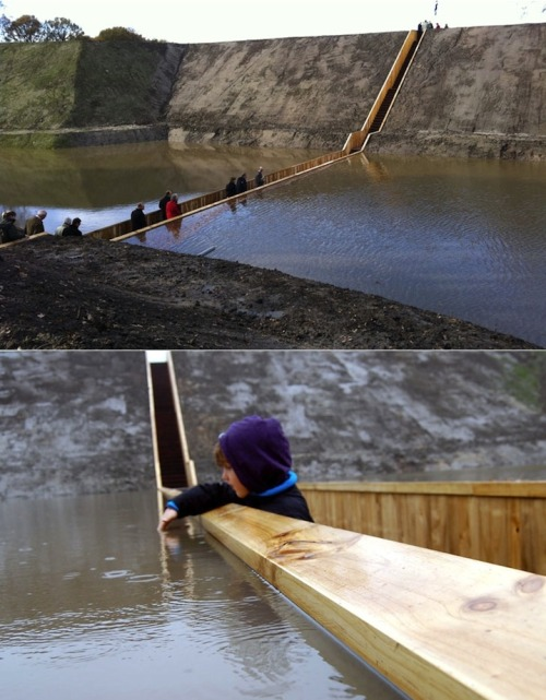 thedailywhat:  Badass Bridge of the Day: The Moses Bridge, as its name suggests, is pedestrian bridge that creates the illusion of walking through water — in this case, the West-Brabant waterline near Fort de Roovere in the Netherlands. Designed by RO & AD Architects, the bridge was built using Accoya wood, a type of modified wood that offers the enhanced durability necessary to sustain a sunken bridge. [accoya / inhabitat / mmm.]