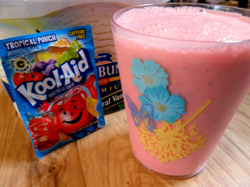 gourmetgrubbz:  Kool Milkshake Don't even judge this until you try it. Blend together vanilla icecream, or maybe some fruity kinda icecream, bananas, strawberries or other favorite fruit, and then add a little pizazz to the mix with some kool-aid. I tried tropical punch, but I bet it would have been absolutely amazing with berry blue or black cherry. In addition to the teaspoon of tropical punch mix, was half a banana, about a cup of vanilla ice cream and and half cup of milk. Voila. Be sure not to overwhelm the shake with a whole packet, add a little here and there to see what tastes better to you. If you like sour things, then just go head and drop in the whole packet if you dare to.