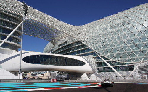 Adrian Sutil (Force India) passing under the Yas Viceroy Hotel, spanning the Yas Marina Circuit and centerpiece of Yas Island, during Free Practice for the Abu Dhabi Grand Prix.