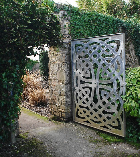 Celtic knot gate leads into a hidden backyard garden (via Garden | RedBubble)