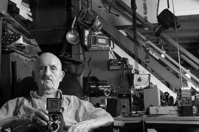 Cameras! Image: A 95-year-old photographer with his cameras, a submission to National Geographic's current $10,000 photo contest via The Atlantic.