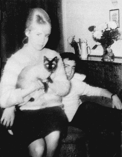 beatlesneveroutofstyle:  John and Cyn at John's Aunt Mimi's house in October 1962. Cynthia is holding one of Mimi's cats and she was also pregnant with Julian in this picture.