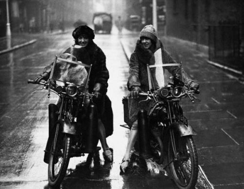 "ca. 1925, England — The fashion conscious Debenham sisters ride their motorcycles wearing fun winter coats. — Image by © Hulton-Deutsch Collection/Corbis (via ""FOUR WHEELS MOVE THE BODY — BUT TWO WHEELS MOVE THE SOUL."" « The Selvedge Yard)"