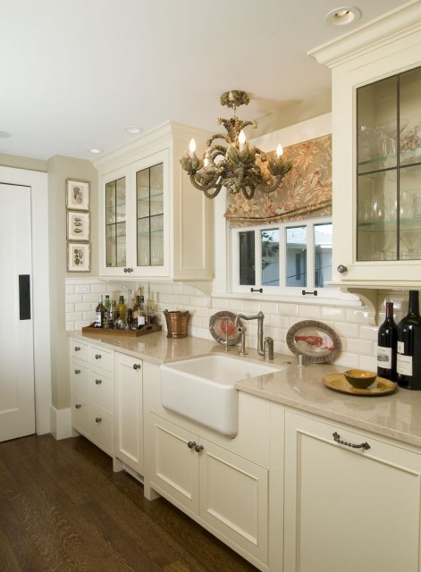 A pretty traditional kitchen with wood floor, glass-fronted cupboards, and a separate pantry. Love that chandelier! (via Pantry - traditional - kitchen - san francisco - by Camber Construction)