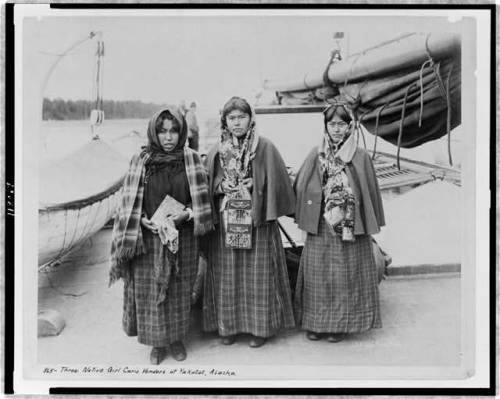 """Three native girl curio venders at Yakutat, Alaska.""  Miles Bros., 1903."
