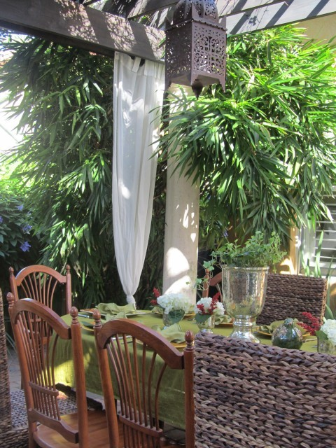 Beautiful outdoor tropical dining area surrounded by lush greenery (via Outside - patio - miami)