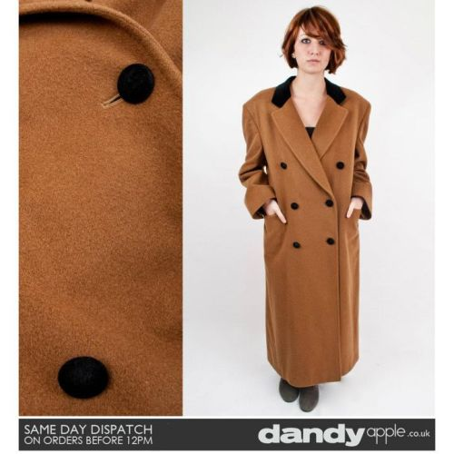 Newly listed @ www.dandyapple.co.uk Link: http://bit.ly/uXzxES Womens Vintage Retro Burberrys' Light Brown Cashmere Wool Heavy Commuter Style Coat. *   Brown in colour, made from 100% Cashmere wool. *   Double breasted design, fastening with round black covered buttons. *   Two open pockets on the hips. *   Fully lined inside with a light brown nylon material *   Sam is a size 8, 5ft 6 inches tall. Size: 14 Material: 100% Cashmere Condition: Some light signs of previous wear, nothing major. No visible marks or stains. Overall, great used vintage condition. More items like this are available here: http://bit.ly/szLgZW