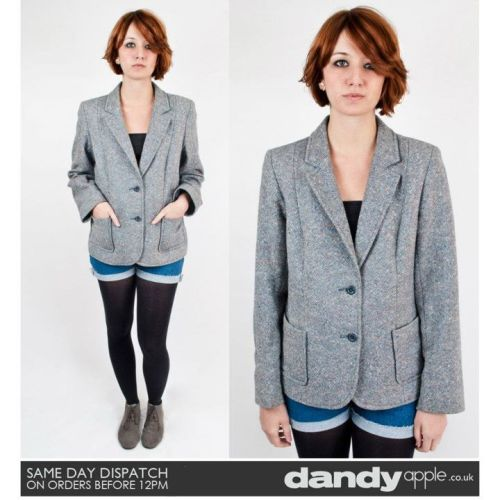 "Newly listed @ www.dandyapple.co.uk Link: http://bit.ly/tVu0xk Womens Vintage Retro Grey Two Button Fastening Pure New Wool Blazer Jacket. *   Grey in colour, with a grey polyester lining inside. *   V neck collared neckline. *   Fastens with two small round dark grey buttons. *   Two open pockets on the hips. *   Label reads; ""Hyphen - Pure New Wool - Dry Clean Only"" *   Sam is a size 8, 5ft 6 inches tall. Size: 10-12 Material: Pure New Wool Condition: No visible faults, marks or stains. Great overall used vintage condition. More items like this are available here: http://bit.ly/uTRbjg"