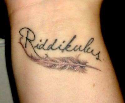 This is my newest tattoo. I chose to get the Riddikulus spell because I am scared of pretty much everything, so I wanted something to remind me that no matter what monsters I face, I can always make them humorous and easy to overcome. The feather is based on one from the Magical Quill Challenge used for the Beta testing for Pottermore.  It was done by Chris Reed at RedLetter1 in Hyde Park, FL. I have nothing but good things to say about this studio and the talent within it! -icedelegance