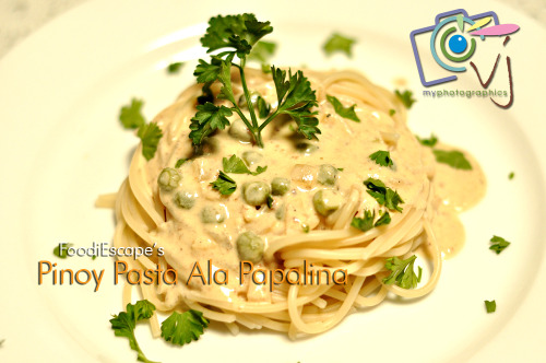 "Pinoy Pasta Ala Papalina13 Nov 2011 | Angono The Pasta Ala Papalina is a white sauce pasta recipe, my second time to cook this recipe which I got from a cooking show that is not airing anymore. I've made some tweaks on MY FIRST TRY, I put tuna flakes instead of the chopped prosciutto as stated in the original recipe.  »my first Pasta Ala Papalina This time, I made it more Pinoy. I experimented with a Salted Dried Fish (Tuyo) given to me by a friend and I'm very impressed of what it turned out. Dried fish must be deboned and chopped finely. Delicious way to eat tuyo is to prepare some great and creative dish out of it. Fettuccine alla papalina, or ""Fettuccine for the Pope"", is an upscale reinterpretation of the earthy spaghetti alla carbonara. The story goes that the dish was prepared for a certain Cardinal Pacelli, who was soon to be come Pope Pius XII, who had asked the ownder of a restaurante in the Borgo (the area of Rome that lies between the Vatican and the Tiber River) to make him a more delicate version of the classic Roman dish. ~memoriediangelina Same procedures as what memoriediangelina has given in her recipe. I just substituted the chopped prosciutto again with a minced salted dried fish, sauteed in butter, pour some wine after the garlic & white onions, making it odorless yet making it more flavorful.  It's important to whisk your milk and cream well and evenly, becoming your sauce smoother and creamier. Don't forget the eggyolks! ;) I always love making FoodiEscape recipes with a Pinoy touch and a guaranteed customized food creations. Here's to Manny Pacquiao's victory. Mabuhay ang Pinoy! Photo by VerJube Photographics."