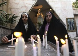 مسلمات وشموع في كنيسة كلدانية ببغداد Iraqi Muslim women light candles at the Virgin Mary Chaldean Church in central Baghdad, Iraq, Sunday, Nov. 13, 2011. The Chaldean church is an Eastern Rite church affiliated with the Roman Catholic church. (AP Photo/Khalid Mohammed) عام على حادث كنيسة سيدة النجاة بالكرادة، بغداد