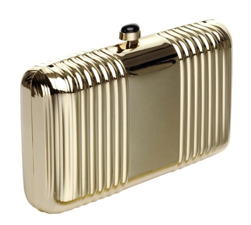 "A great gleaming accessory to fancy up your LBD or the perfect holiday gift for the fashionista in your life. ""Mabel"" hard-case clutch, $170, reissonline.com"