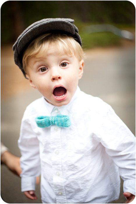 Such a cute kid, and he's rocking a knitted bowtie!