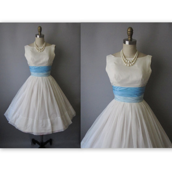 bridalfrocks:  Vintage 50s blue sash wedding dress - $224  A lot of vintage wedding dresses don't look very good but I would wear this one in a heartbeat!  And for that price!