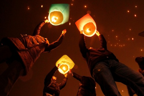 St. Petersburg, Russia: Hundreds of paper lanterns are launched into the sky as part of a flash mob. Dmitry Lovetsky / AP More Photos of the Day.
