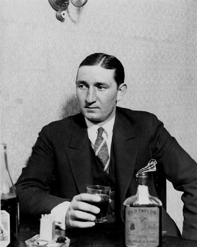 "Ray ""the Fox"" Renard, former gangster with Egan's Rats, enjoys a Prohibition-era swig in February 1925, shortly after testifying against his former cronies in federal court. Renard, 26, had grown up in an orphanage and was a young pickpocket when he joined the gang. Egan's Rats was formed in Kerry Patch, the Irish neighborhood northwest of downtown, and muscled into bootlegging during Prohibition, but its specialty was big-time robbery. Renard was sent to federal prison for a freight-car robbery and, upon hearing that his fellow gangsters might try to kill him to keep him quiet, went to the prosecutors. He said he knew all about two big heists, the $2.4 million robbery of bonds and cash from a mail truck at Fourth and Locust streets on April 2, 1923, and of a $54,000 payroll robbery at the Staunton, Ill., train station the following May 26. When the picture was taken, he was soon to be returned to federal prison. (St. Louis Star) More photos »"
