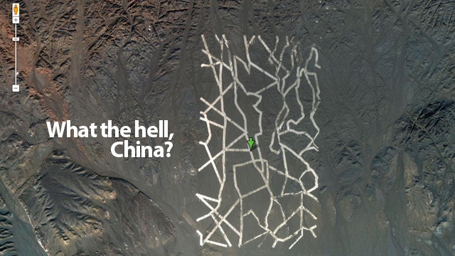 Why Is China Building These Gigantic Structures In the Middle of the Desert? Lots of strangeness going on on Google Maps thanks to China. Ideas? I think it's part of a new effort to erode the American worker's productivity by having them spend so much time looking at stuff on Google Maps instead of continuing to be exceptional innovators.  This is crazy. New photos have appeared in Google Maps showing unidentified titanic structures in the middle of the Chinese desert. The first one is an intricate network of what appears to be huge metallic stripes. Is this a military experiment?  (via Gizmodo)