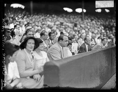 chicagohistorymuseum:  Al Capone at a baseball game at Comiskey Park, 1931. Before the end of the baseball season, Capone would be indicted on charges of tax evasion and failure to file tax returns. Want a copy of this photo?  > Visit our Rights and Reproductions Department and give them this number: DN-0096548. Want to buy a book?> Purchase Historic Photos of Chicago Crime: The Capone Era