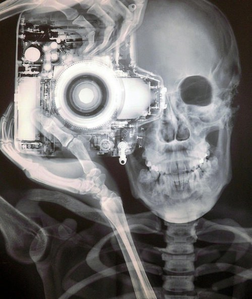 laughingsquid:  X-Ray Image of Photographer and Camera by Nick Veasey