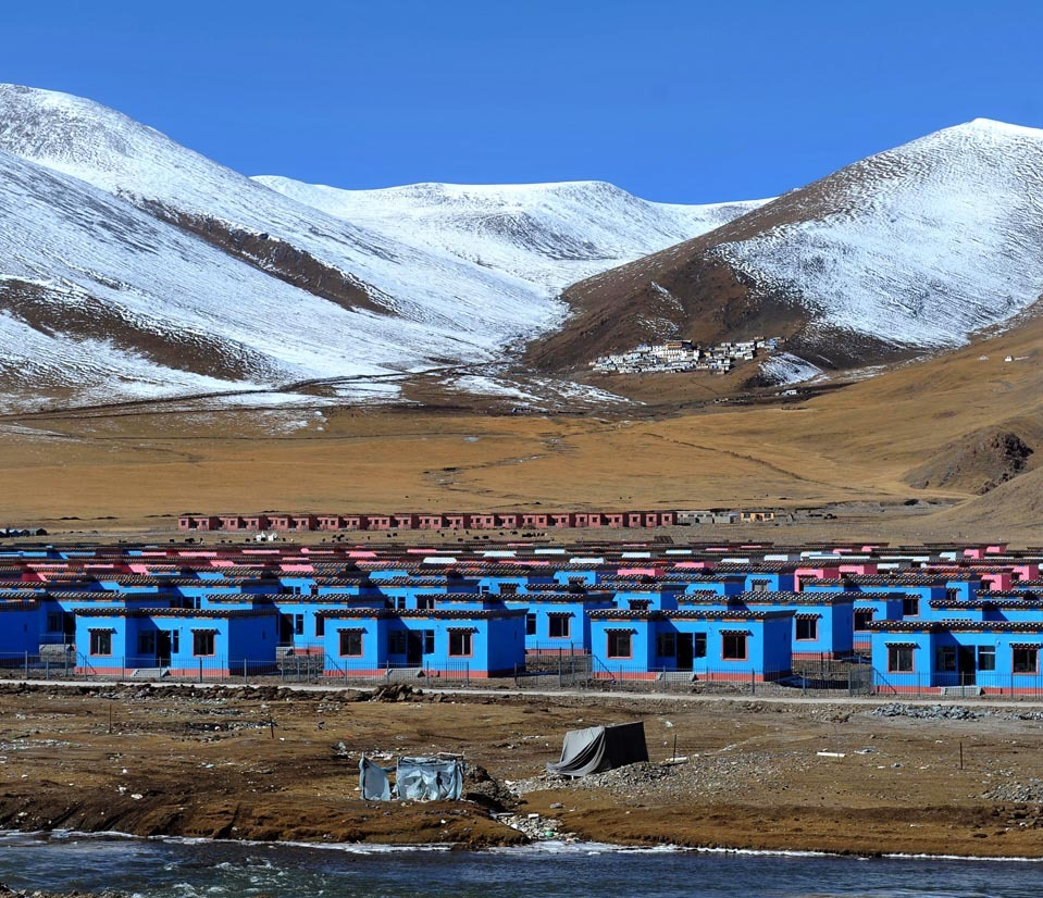 New houses being built for earthquake survivors stood in Yushu, Qinghai Province, China, Sunday. More than 2,000 people died in the April 2010 earthquake in the area.  [Credit : Agence France-Presse/Getty Images]