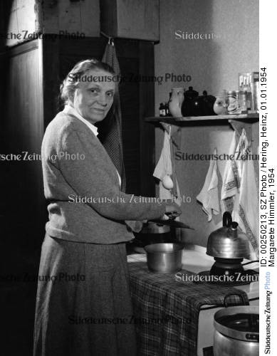 kathazahler:  Photo of Margarete Himmler 1954 cooking.  She won't allow Heinrich to cook, because cooking was woman's work and if he was to cook than he was to do all the work that was deemed woman's work.  Heinrich learned to cook when he was in college and his parents couldn't fit in the budget a maid for the brothers to have like they did the previous year.     Frau Himmler. An interesting fact: According to Gebhardt (Heini's elder brother), It was Marga's blond hair what Himmler found more attractive about her.