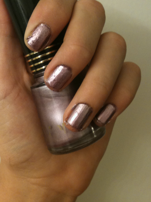This is the Revlon nail enamel in lavendare. When I first saw this color, I thought it was ugly but now I think it's actually a really gorgeous color! It's a light purple with a grey touch, and a little metallic. This color is great for fall and is not to flashy!