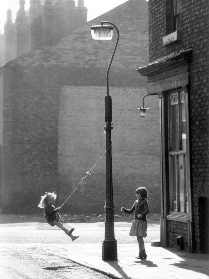 m3zzaluna:  shirley baker, two girls swing on a lampost, manchester, 1965 Thanks to m3zzaluna.