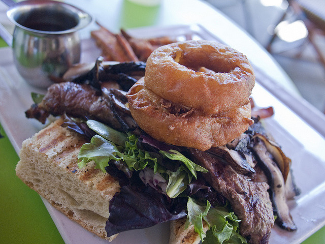 Steak Sandwich topped with onion rings