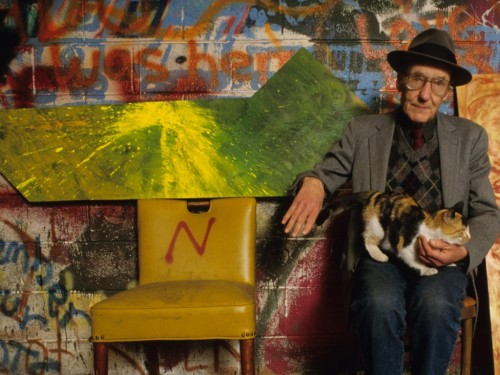 William Burroughs and kitty, alive in old age, against all odds.