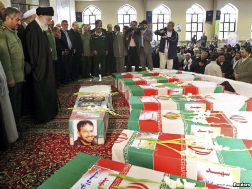 Iran Buries Missile Commander Killed In Blast, Amid Speculation About Israel's Role Photo Caption: Supreme Leader Ayatollah Ali Khamenei (second from left) and Revolutionary Guards commander Mohammad Ali Jafari (left) stand next to the coffins of 17 members of the Revolutionary Guards who were killed in a blast at a military base last week.