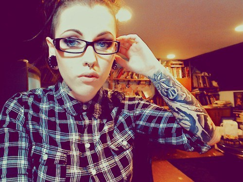 Looks like hardcore. -> Tunnels and septum. http://piercingprincess.tumblr.com/