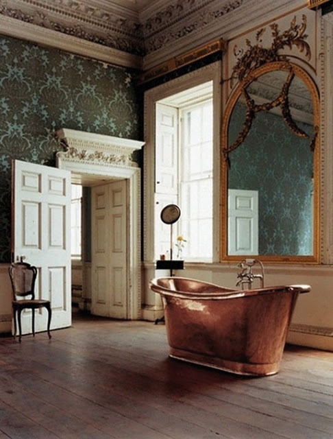 A palatial French Rococo room is remodeled into a bathroom… the original design elements are undisturbed, and the free-standing copper bathtub seems to blend effortlessly into it's new surroundings. Look at that amazing mirror! (via Tassels Twigs & Tastebuds: A freestanding fantasy…)
