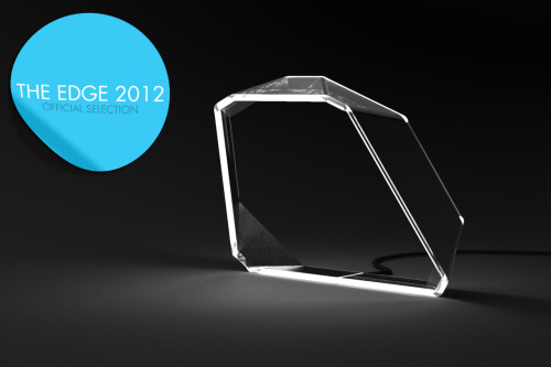 Adamus Lux - Official Selection for the Edge 2012. A desk light made from a single piece of frosted acrylic and wrapped in an outer layer of brushed aluminium, the Adamus Lux combines the diffusion of light through its edges with an incorporated LED bank at the apex to create a soft perimeter of light that envelopes the form that intersect to create an area light suitable for both mood and task lighting. The Adamus Lux comes with both brightness and colour controls, allowing the user the alternate the output of the Adamus Lux between moodier yellow tones and more task-oriented blue tones, and anywhere in between.