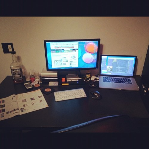 My current setup. #mac #apple #dell #setup #laptop #adobe #jackdaniels #desktop (Taken with instagram)