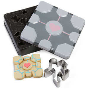 Portal Cookie Cutters: Having fun … with baking! Shapes include portal, turret, two different test subjects and, of course, the companion cube.   Available from ThinkGeek