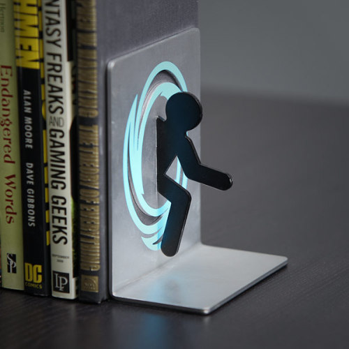 Portal Bookends - by ThinkGeek  Who knew that portals would make wonderful bookends?  (via pwnlove)