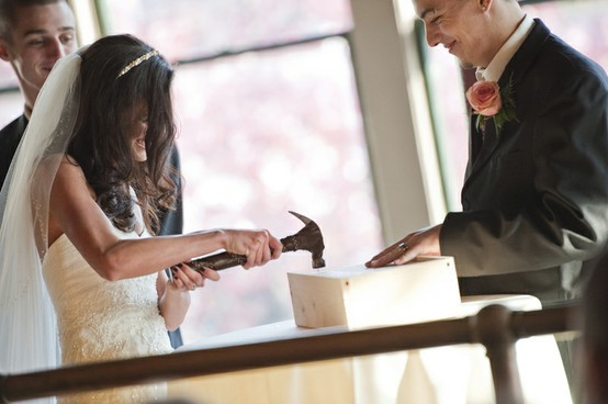 Prior to the wedding, you gather a strong wooden wine box, a bottle of wine and two glasses. Then, also before the ceremony, you both sit down separately and write love notes to each other, explaining your feelings on the eve of your wedding day. Each letter then gets sealed in its own envelope. You do not read your beau's letter. Then, at some point during the ceremony, your officiant explains the process, and the two of you seal the box by taking turns hammering in one nail at a time until the box is closed.  You don't open the box until your 10th anniversary (or really whatever anniversary you choose. Either way, on the day that you open the box, you both read the letters and drink the wine, remembering how you both felt just days before your wedding day.