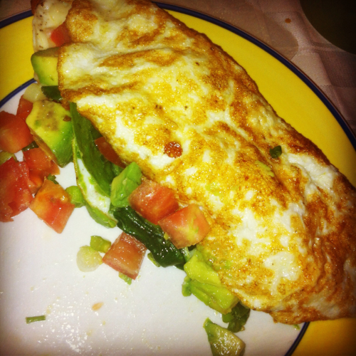 "danins:  Healthy Egg White Omelet One of my all time favorite ""go-to"" breakfasts is the egg white omelet. Healthy, high protein, filling, and delicious, there's nothing more one could ask for in a meal to start their day! (unless that is you're more of a sweet person than a savory person…in which case sorry!) I also adore it because it takes about 10 minutes to make. So, here is how I personally make my egg white omelets! *Things you will need: 2-3 eggs (I just lifted, so I used 3 for extra protein) 1/4 of a Roma tomato, chopped 1 scallion, chopped 1/4 of an avocado, chopped Approx. 1/4 cup of baby spinach (I use enough to cover half the omelet) A sprinkling of low fat mozzarella cheese 2 tsp of extra virgin olive oil Separate your eggs. You can do this by cracking them in half and transferring the yolk between the two shell halves over a bowl, causing the whites to drip into the bowl and the yolk to remain in the egg shell. Discard of shells and yolks, unless you want to use them for a deep conditioner (which I'll write up at another point). Whisk your egg whites until little frothy bubbles start to form. Heat up olive oil in a pan over medium heat. Add the egg whites. When they have become mostly white, meaning only the told layer is clear, sprinkle the cheese evenly over the entire omelet. Next lay down the baby spinach on only half of the egg suface, and top it with the rest of your chopped vegetables. Fold the side without any veggies on it over using a spatula, and let sit approx. 10-15 second. Remove omelet from pan, let set about a minute so the inside finishes cooking, enjoy! *you can use any vegetables you like this is just the way I personally like my omelet."