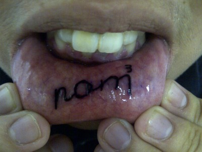 "Got this tattoo on impulse.  Basically it is ""nom nom nom"" which means eating.  I live to eat!"