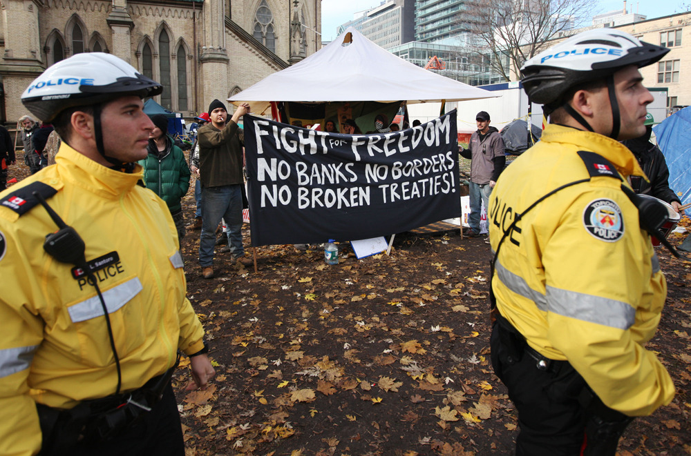 "Occupy Toronto protesters given midnight deadline to leave parkBylaw officers have served eviction notices to Occupy Toronto protesters  just a day after Mayor Rob Ford reiterated warnings that the city would  move ""soon"" against the encampment.Just hours after the forced removal of the New York camp where the  Occupy movement first took root, Toronto police accompanied bylaw  officers pinned sheets of paper to tents requesting that all traces of  the campsite be removed immediately. (Photos: Darren Calabrese/National Post)"