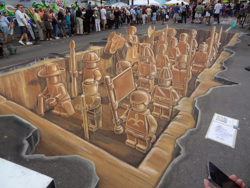 9-bits:   For the 4th Sarasota Chalk Festival, artists Leon Keer, Ruben Poncia, Remko van Schaik and Peter Westerink made a three-dimensional drawing on the ground that was inspired by the Terracotta Army.  (via Scene 360)