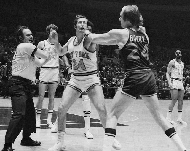 Tempers flare between New York's Bill Bradley and Golden State's Rick Barry during a 1975 game at Madison Square Garden. The contentious scene is appropriate after negotiations between the owners and players fell apart on Monday, leaving the 2011-12 season in jeopardy. (Bettmann/CORBIS)