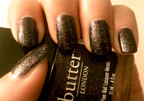 Butter London - The Black Knight This picture seriously does not do it justice. But its the best i could do with my shitty cell phone camera. This is my favorite glitter of ALL TIME. Great application, was opaque in two coats.