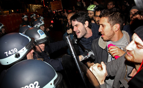 PHOTO OF THE DAY: Occupy Wall Street protesters clash with police at Zuccotti Park after being ordered to leave their longtime encampment in New York on Tuesday. (AP Photo/Craig Ruttle)