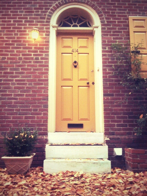 I see a yellow door and I want to paint it black.