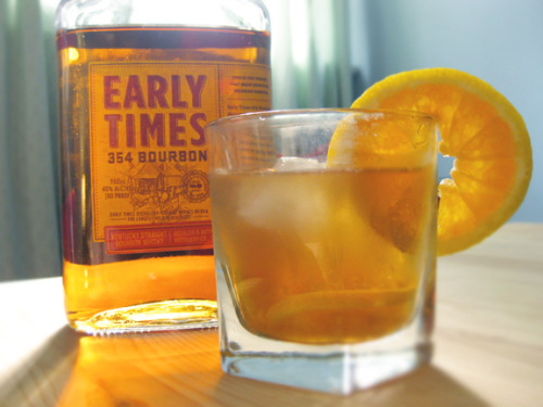 An Old Fashioned made with Early Times Kentucky Whisky.  Old Fashioned Recipe+ 2 oz bourbon whiskey+ 2 dashes Angostura® bitters+ 1 splash water+ 1 tsp sugar+ 1 maraschino cherry+ 1 orange wedgeMuddle sugar with the bitters and orange slice. Top with ice and add in rest of ingredients. Garnish with slice of orange.   Photo credit: Lush Lady
