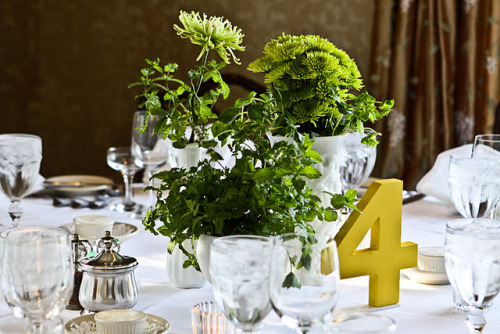 DIY Wooden Table Numbers For Your Wedding Reception! This seems to be a trend in reception decor recently - the affordability of the wooden numbers plus a few coats of paint is the perfect customizable wedding table number solution! (via DIY Wedding Decor: Table Numbers | modernly wed - A Modern Wedding Blog)